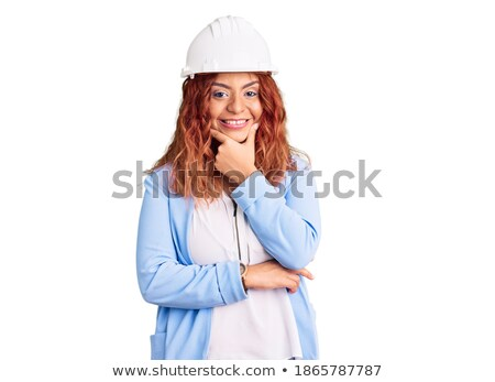 Stock photo: Woman with helmet and hand on chin