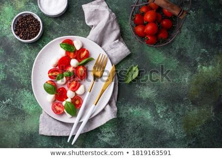 Caprese italiana mozzarella pomodoro insalata cucina italiana Foto d'archivio © shamtor