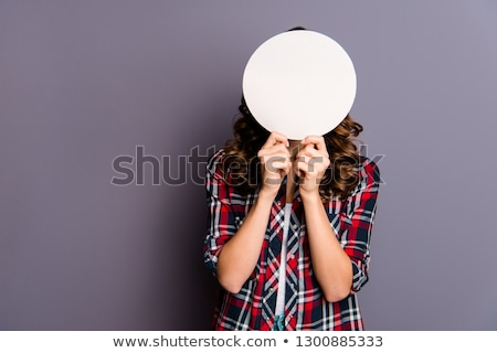 female hiding behind a paper cloud Stock photo © Amosnet