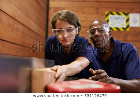 female carpenter with wood plane stock photo © photography33