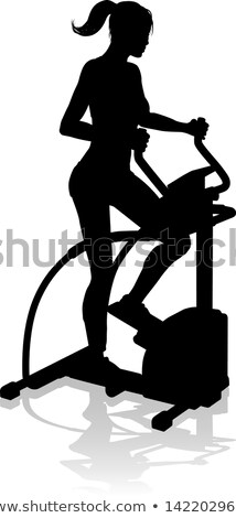Stock photo: Aerobics cardio training woman on elliptic crosstrainer