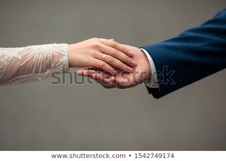 Ifjú pár kezek vőlegény menyasszony jegygyűrűk szeretet Stock fotó © selinsmo