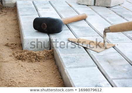 Bricklayer laying blocks Stock photo © photography33