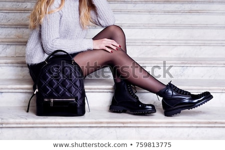 Moça bonita preto perneiras bolsa isolado mulher Foto stock © acidgrey