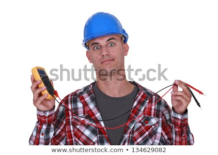 A wide-eyed tradesman holding a multimeter Stock photo © photography33