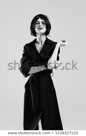 Hartstochtelijk jonge brunette zwarte jas leggings Stockfoto © acidgrey