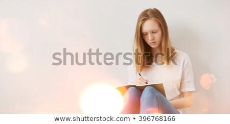 bastante · nina · escrito · cuaderno · sonrisa - foto stock © stockyimages