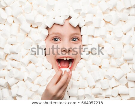 Kid eating marshmallows Stock photo © photography33