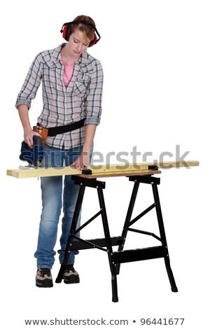 Kadın elektrik testere ahşap inşaat çalışmak Stok fotoğraf © photography33