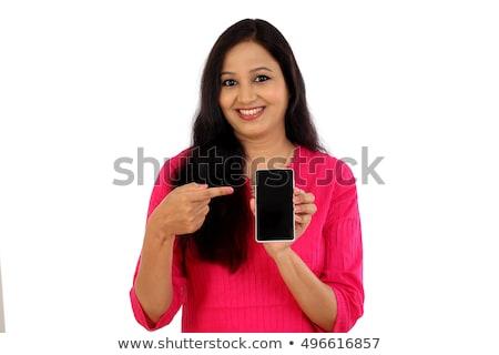 mosolygó · nő · mutat · kamera · fehér · boldog · háttér - stock fotó © wavebreak_media
