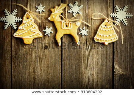 christmas homemade gingerbread cookies over wooden table stock photo © hasloo