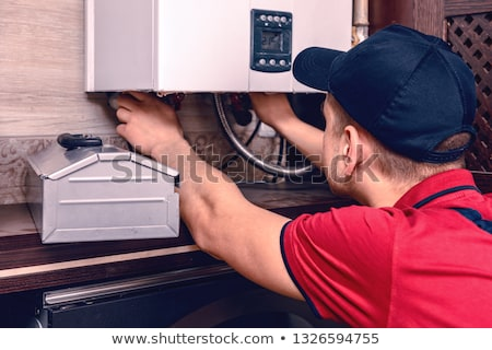Water heater maintenance Stock photo © alexeys