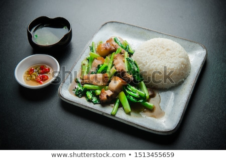 stir fried of chianease kale vegetables with pork stock photo © lekchangply