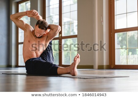 Stock photo: topless young man posing with hands behind head
