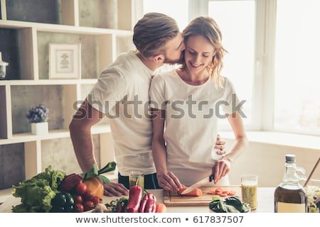 happy couple eating vegetable salad stock photo © hasloo