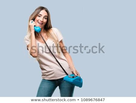 beautiful fashion woman holding a vintage phone stock photo © stepstock