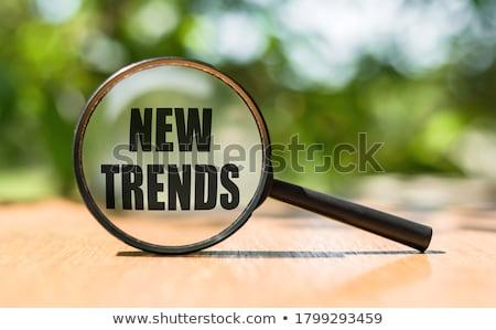 trending written on white paper stock photo © latent