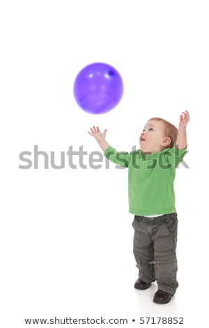 Toddler playing with purple balloon Stock photo © sdenness