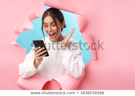 Happy young woman expressing surprise Stock photo © stryjek