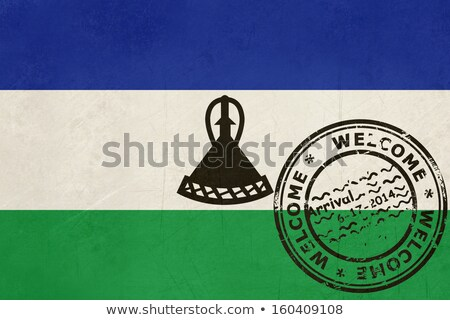 welcome to lesotho flag with passport stamp stock photo © speedfighter