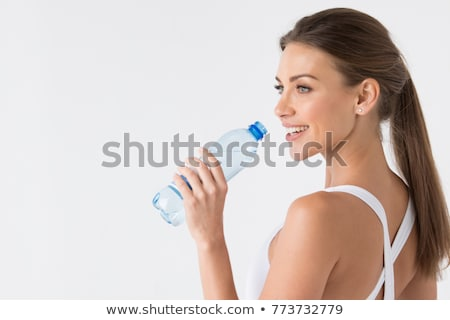 Athletic young woman drinking bottled water Stock photo © stryjek