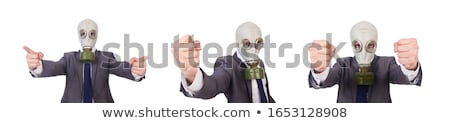 Stok fotoğraf: Businessman Wearing Gas Mask Isolated On White