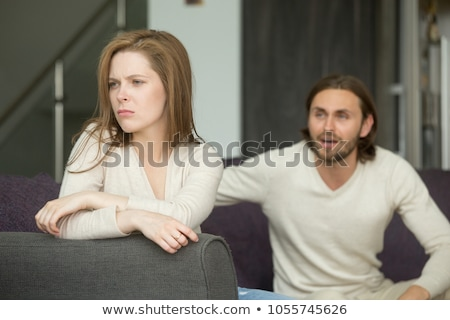 upset young woman with man on the back at home Stock photo © dolgachov
