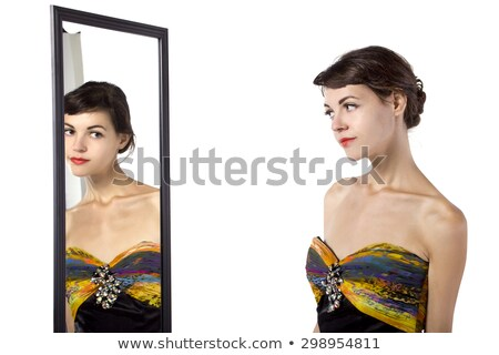 Beautiful woman trying to decide on her makeup Stock photo © dash