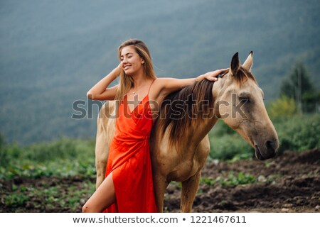 Amazing portrait of blond woman on the horse Stock photo © konradbak