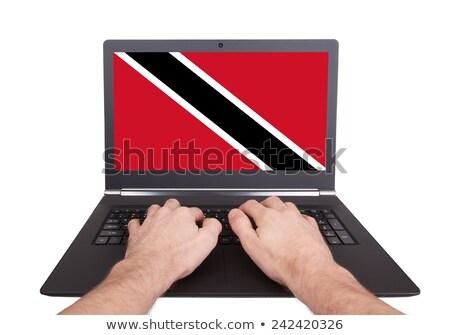 Hands working on laptop, Trinidad and Tobago Stock photo © michaklootwijk