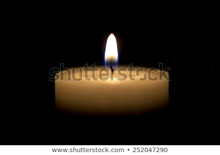 White thick candle with small flame on black Stock photo © hd_premium_shots