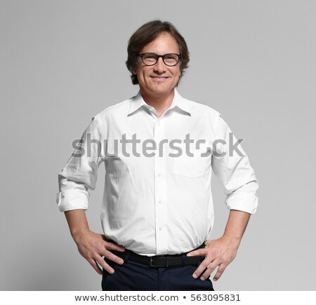 Businessman posing confidently Stock photo © stockyimages