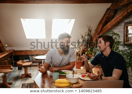 two men having a discussion over breakfast stock photo © ozgur