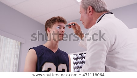 doctor evaluation neck Stock photo © Flareimage