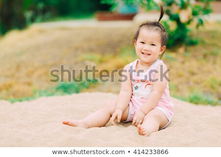 Girl play with shovel in sand on beach. Soft focus. Stock photo © ajfilgud
