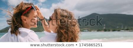 笑みを浮かべて ペア 白 ビーチ 女性 ストックフォト © Paha_L