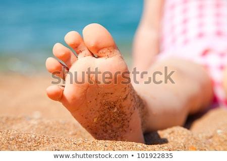 Children's feet on seacoast Stock photo © Paha_L