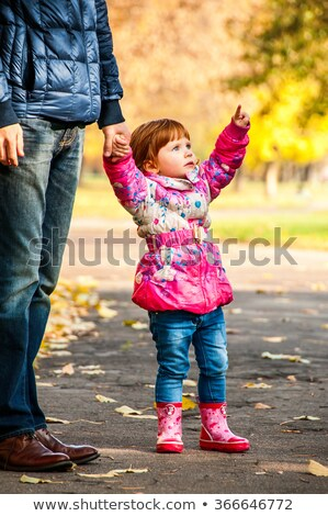 little girl walks with my dad pointing to something in the park stock photo © zeffss