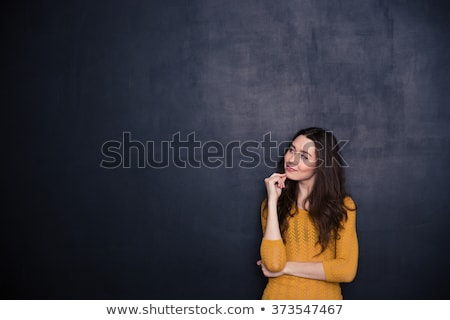 Thoughtful woman looking away at copyspace  Stock photo © deandrobot