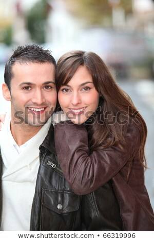 closeup of an embraced young couple in leather jackets stock photo © feedough