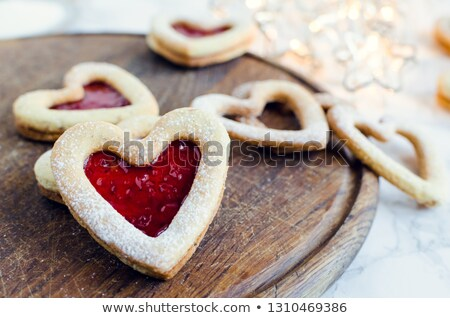 Stock photo: Heart shaped jam biscuit