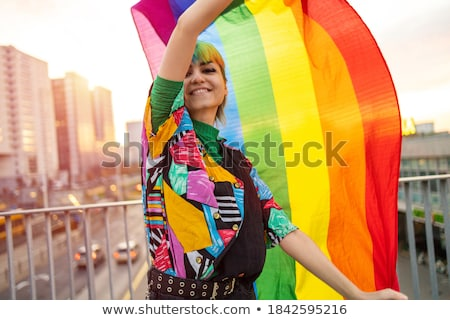 young man waving a gay pride flag Stock photo © nito