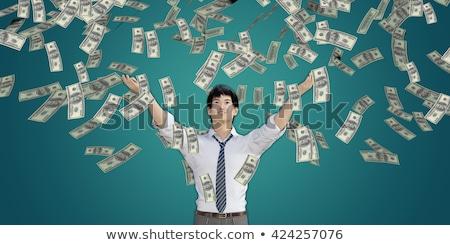 Asian Man Catching Money Falling From The Sky Foto stock © kentoh