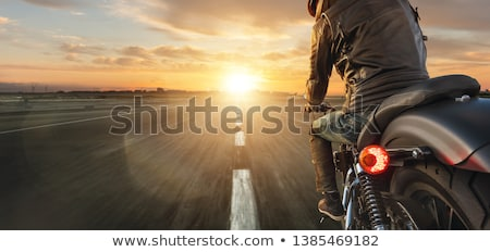 Motorcyclist in the town Stock photo © bezikus