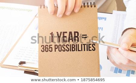 Lehetséges szöveg jegyzettömb kék toll asztal Stock fotó © fuzzbones0