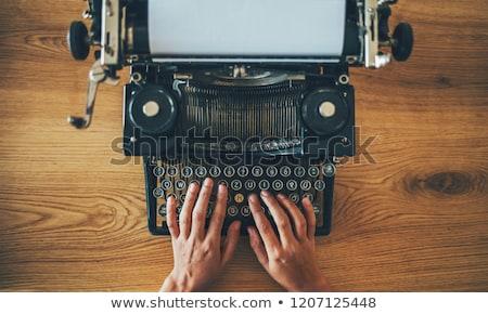 Typing with old typewriting machine Stock photo © carenas1