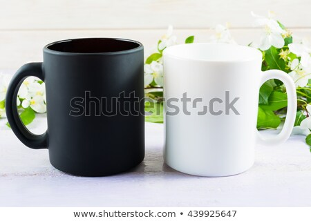Black Coffee Mug Mockup With Apples Photo stock © TasiPas