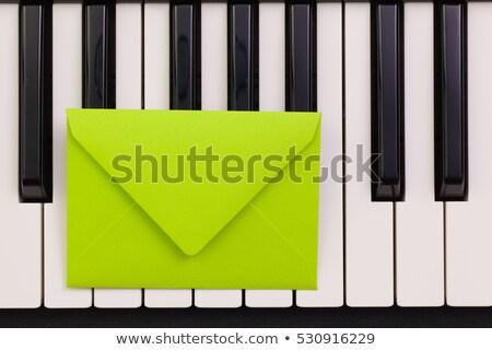 Funny arrangement envelope on the piano keybords  Stock photo © CaptureLight