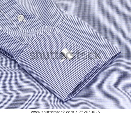 Silver and blue checkered cuff links Stock photo © mybaitshop