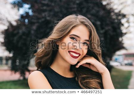 Atraente mulher jovem lábios vermelhos em pé posando azul Foto stock © deandrobot